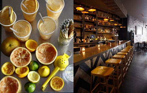 Several squeezed lemons, limes, grapefruits and oranges, with filled glasses and straws/View of bar with empty bar stoolsl